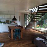 Stahlwangentreppe mit Holzstufen Raumansicht